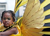 (Port of Spain, Trinidad) 03/01/14 A young masquerader awaits the start of the parade during Trinidad and Tobago's annual Kiddies Carnival in downtown Port of Spain on Saturday, March 1, 2014. Photo by Amanda Sabga.