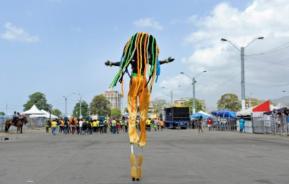 (Port of Spain, Trinidad) 03/04/14 A stilts dancer, known as a Moko Jumbie, revels in Trinidad's Carnival and celebrates through the streets of Port of Spain on Tuesday, March 4, 2014. Photo by Amanda Sabga.