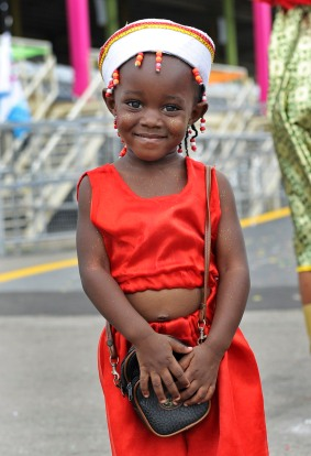 (Port of Spain, Trinidad) 03/04/14 A young girl poses during Trinidad's Carnival and celebrates through the streets of Port of Spain with her family on Tuesday, March 4, 2014. Photo by Amanda Sabga.