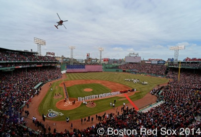 -Boston, MA, April 4, 2014- An american flag drops during the pre-game ceremony as a ceremonial helicopter flyover takes place before the start of an opening day game against the Milwaukee Brewers at Fenway Park on April 4th, 2014 at Fenway Park in Boston, Massachusetts. (Photo by Amanda Sabga/Boston Red Sox)