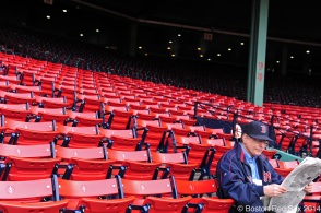 -Boston, MA, April 8, 2014- A man reads the newspaper while general preparations before a game against the Texas Rangers at Fenway Park on April 8th, 2014 at Fenway Park in Boston, Massachusetts. (Photo by Amanda Sabga/Boston Red Sox)