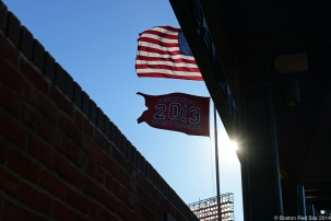 -Boston, MA, April 9, 2014- The US flag and Word Series flag fly over Fenway Park during a game against the Texas Rangers at Fenway Park on April 9th, 2014 at Fenway Park in Boston, Massachusetts. (Photo by Amanda Sabga/Boston Red Sox)