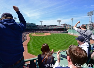 -Boston, MA, April 21, 2014- Fans celebrate during a game against the Baltimore Orioles at Fenway Park on April 21st, 2014 at Fenway Park in Boston, Massachusetts. (Photo by Amanda Sabga/Boston Red Sox)