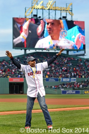 -Boston, MA, April 23, 2014- 2014 Boston Marathon winner Meb Keflezighi waves to fans before throwing the ceremonial first pitch during pre-game ceremonies before a game against the New York Yankees at Fenway Park on April 23rd, 2014 at Fenway Park in Boston, Massachusetts. (Photo by Amanda Sabga/Boston Red Sox)