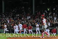 -Boston, MA, May 6, 2014- Red Sox players celebrate after a walk-off win against the Cincinnati Reds at Fenway Park on May 6th, 2014 at Fenway Park in Boston, Massachusetts. (Photo by Amanda Sabga/Boston Red Sox)