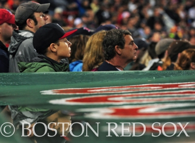 -Boston, MA, May 16, 2014- A young fan watches as his image reflects on the rainy dugout during a game against the Detroit Tigers at Fenway Park on May 16th, 2014 at Fenway Park in Boston, Massachusetts. (Photo by Amanda Sabga/Boston Red Sox)