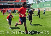 -Boston, MA, May 17, 2014- Jackie Bradley Jr. runs drills with kids as part of a Health and Wellness event hosted by Covidien on May 17th, 2014 at Fenway Park in Boston, Massachusetts. (Photo by Amanda Sabga/Boston Red Sox)