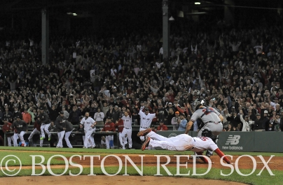 -Boston, MA, May 29, 2014- Jackie Bradley Jr. slides into home to score the winning run during a game against the Atlanta Braves on May 29th, 2014 at Fenway Park in Boston, Massachusetts. (Photo by Amanda Sabga/Boston Red Sox)