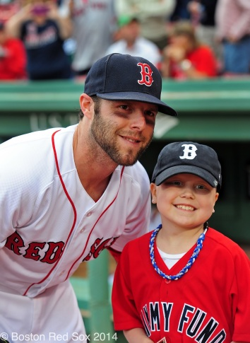 -Boston, MA, June 12 2014- Emma Tierney from the Jimmy Fund poses with Dustin Pedroia before throwing out the ceremonial first pitch before a game against the Cleveland Indians on June 12th, 2014 at Fenway Park in Boston, Massachusetts. (Photo by Amanda Sabga/Boston Red Sox)