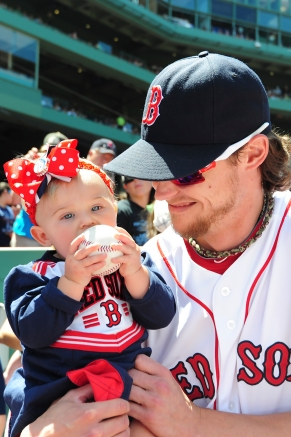 -Boston, MA, July 6 2014- Clay Buchholz and his daughter during Red Sox family day pre-game ceremonies before a game against the Baltimore Orioles on July 6th, 2014 at Fenway Park in Boston, Massachusetts. (Photo by Amanda Sabga/Boston Red Sox)