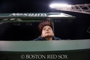 -Boston, MA, August 19, 2014- A young fan looks over the monster during a game against the Los Angeles Angels at Fenway Park on August 19th, 2014 (Photo by Amanda Sabga/Boston Red Sox)