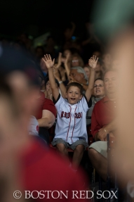-Boston, MA, September 6, 2014- A young fan cheers during a game against the Toronto Blue Jays at Fenway Park on September 6th, 2014 (Photo by Amanda Sabga/Boston Red Sox)