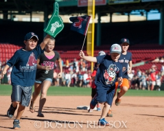 -Boston, MA, September 7, 2014- Kids run the bases after a game against the Toronto Blue Jays at Fenway Park on September 7th, 2014 (Photo by Amanda Sabga/Boston Red Sox)