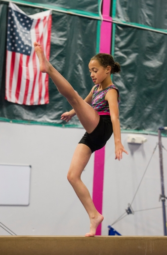 AMANDA SABGA/ Staff photo Mackenzie Thurell, 9 of Haverhill, walks the beam during a summer gymnastics camp host by the Haverhill YMCA. 6/26/15
