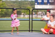 AMANDA SABGA/ Staff photo A young girl Dance on stage with members of the Lawrence High School Dance Company at the Light up Lawrence event in celebration of the fourth of July at the Veterans Memorial Stadium. 7/3/15