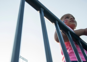 AMANDA SABGA/ Staff photo Six-year-old Jeilianys Almanzar, of Lawrence, watches as performances take place during the Light up Lawrence event in celebration of the fourth of July at the Veterans Memorial Stadium. 7/3/15