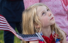 AMANDA SABGA/ Staff photo A young girl looks up to the sky as Salem celebrates Independence Day with festivities and fireworks at the Salem Maritime National Historic Site on Derby Wharf. 7/4/15